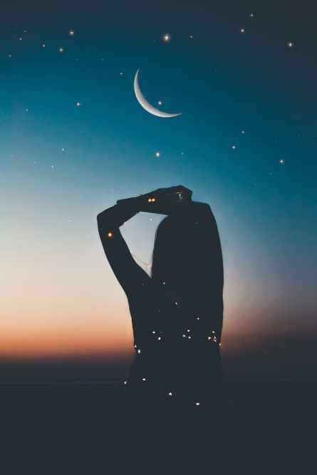 silhouette of person under starry night artwork